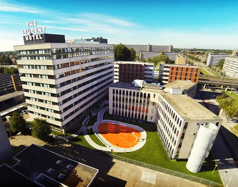 Drone view of The Student Hotel Amsterdam West on a sunny day