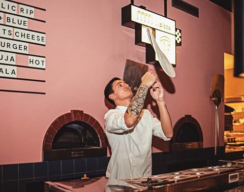 Chef makes a pizza base at The Commons restaurant and bar at The Student Hotel Amsterdam City