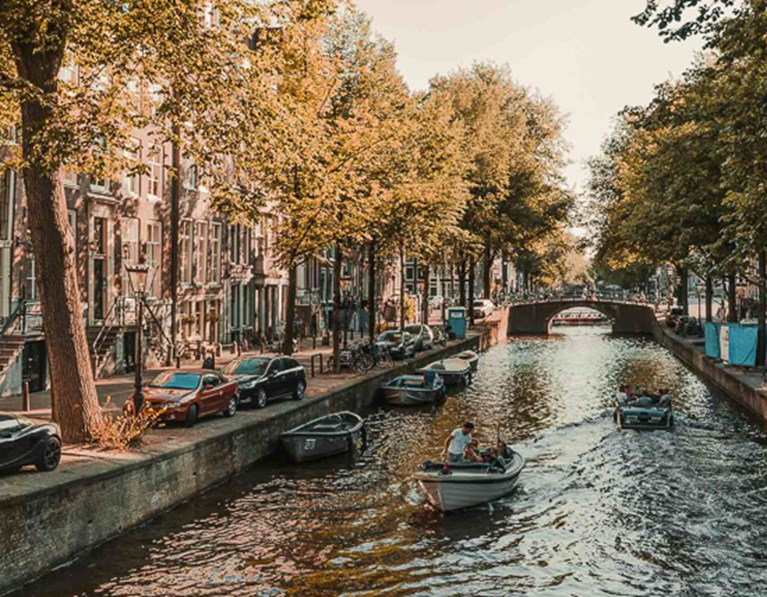 View of canal with boats near The Student Hotel Amsterdam City