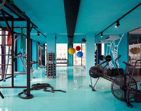 Weights and cardio equipment in the blue gym at The Student Hotel Eindhoven