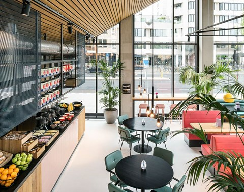 Breakfast buffet and dining area at The Commons restaurant at The Student Hotel Eindhoven