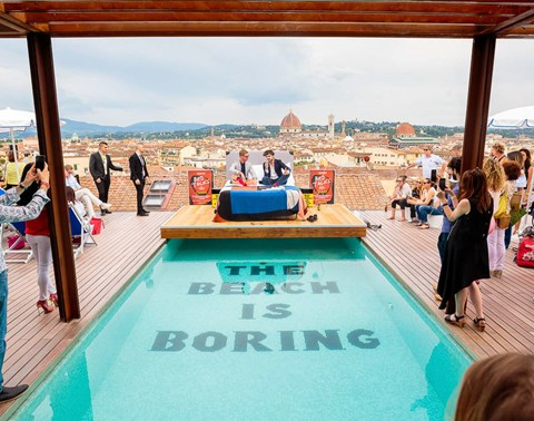 Crowd on the rooftop pool terrace at BedTalks ideas festival at The Student Hotel Florence Lavagnini