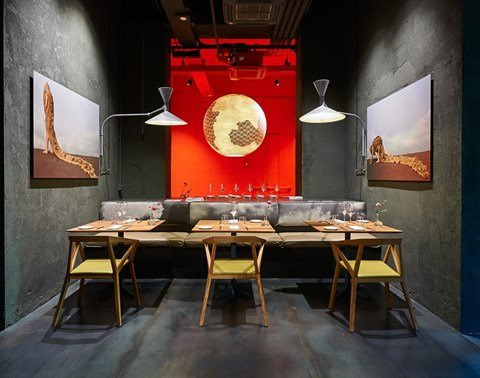 Private dining room with red illuminated wall at The Student Hotel Florence Lavagnini