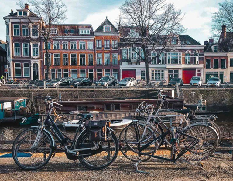 Bikes parked along a bridge in Groningen, close to The Student Hotel