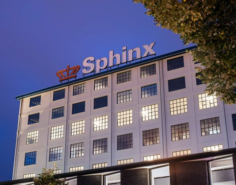 Cropped image of white facade of The Student Hotel Maastricht with 'Sphinx' signage
