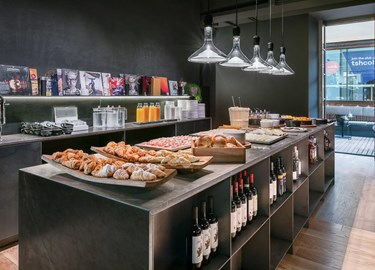 Pastries, hot food, juice and water on display at OOO restaurant at TSH Florence