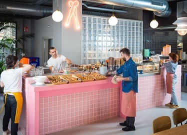 Guests serve themselves from the pink breakfast buffet at TSH Campus Barcelona Marina