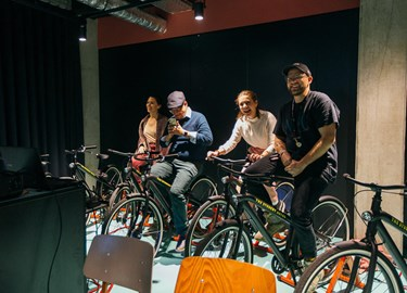 Group of guests test bikes at a bike workshop at The Student Hotel Amsterdam City