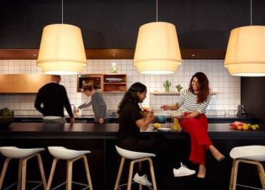 Colleagues take a lunch break in the communal kitchen at The Student Hotel Amsterdam City