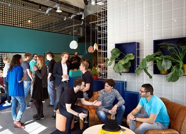 Guests network in the cafe space at TSH Collab at The Student Hotel Delft